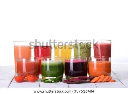 Fruit juice ( grape , strawberries , orange , kiwi , grapefruit , apple ) & vegetable juice ( tomato . cucumber , beets , carrots ) - stock photo