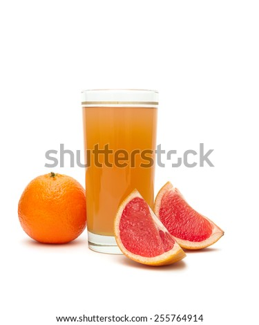 fruit juice in a glass, tangerine and grapefruit on a white background. horizontal photo. - stock photo