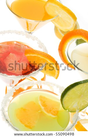 Fruit juice in cocktail glass on white background