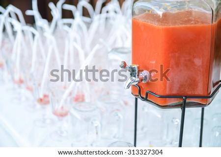 Fruit Juice in Water Cooler Tank - stock photo