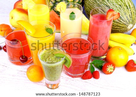 Fruit juice with kiwi, apricot, cherry, watermelon, tangerine and pear, top view