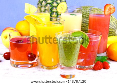 Fruit juice with kiwi, cherry, melon, tangerine, pear and apricot, close up - stock photo