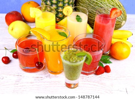 Fruit juice with kiwi, cherry, melon, tangerine, pear, apricot, horizontal