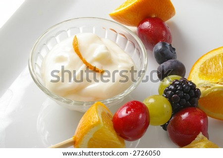 Fruit kabobs with citrus yogurt cream. - stock photo