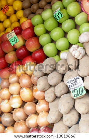 Fruit laid out on sale with price lists