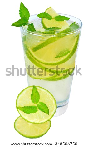 Fruit lemonade with lime and ice cubes and leaf mint on a white background.