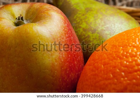 fruit macro image, showing texture in fruit skin. apple, orange and pear close up. orchard and citrus fruit . - stock photo