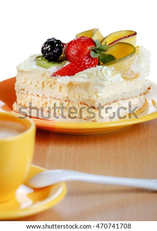 Fruit mango cake and cup of coffee