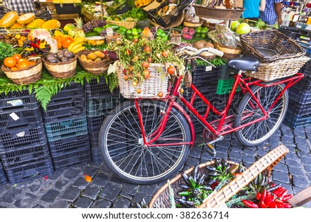 Fruit market with old bike in Campo di Fiori, Rome - stock photo
