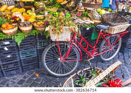 Fruit market with old bike in Campo di Fiori, Rome - stock photo