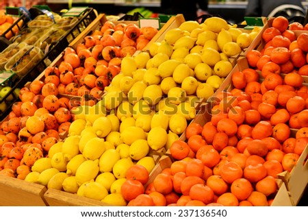 Fruit market with various fresh fruits and vegetables. Supermarket - stock photo