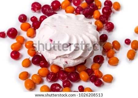 Fruit marshmallow and frozen berries on white background