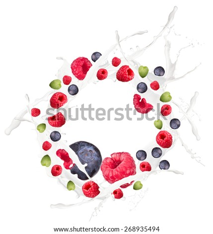 Fruit mix, blueberry, raspberry in milk splash, isolated on white background
