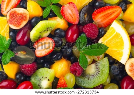 Fruit. Mix of fresh fruits and berries. raw food ingredients. nutrition background - stock photo