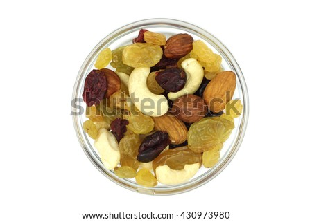 fruit nut mixture in a glass cup on a white background