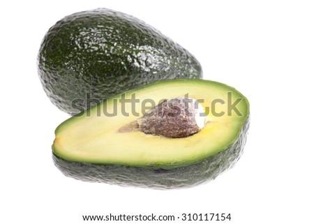 fruit of cut avocado with stone isolated on white background - stock photo
