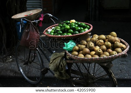 Fruit on a bicycle in an asian city. - stock photo