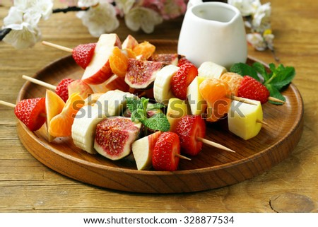 fruit on wooden skewers - dessert skewers - stock photo