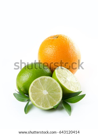 Fruit. Orange lemon lime and green mint leaves on white background