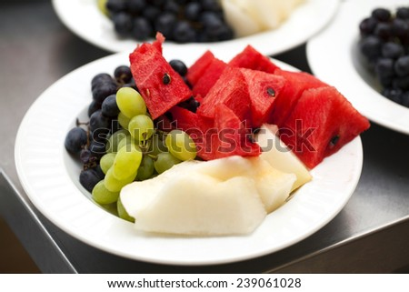 fruit plate of watermelon melon grapes green blue - stock photo