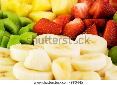 Fruit plate with bananas, strawberries, kiwis and pineapple