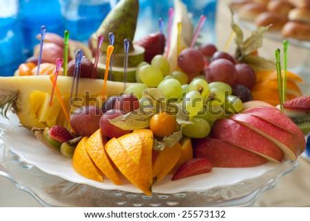 Fruit platter, banquet table arrangement, shallow dof - stock photo