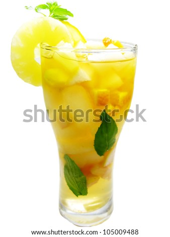 fruit punch cocktail drink with pineapple lemon and ice - stock photo