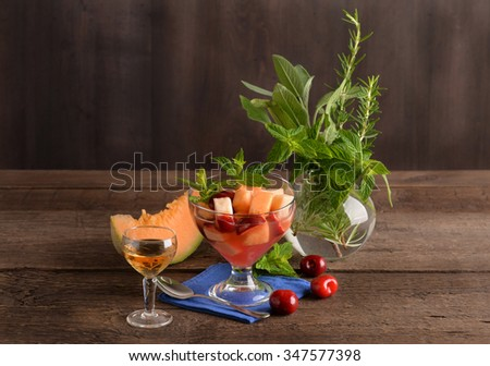 Fruit salad and wine and spices - stock photo