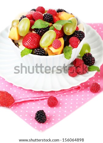 Fruit salad in bowl, isolated on white