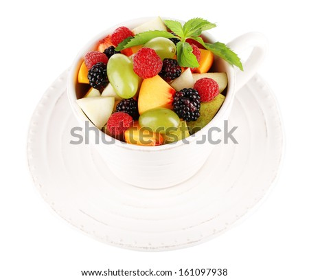 Fruit salad in cup isolated on white