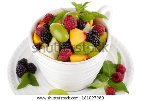 Fruit salad in cup isolated on white - stock photo