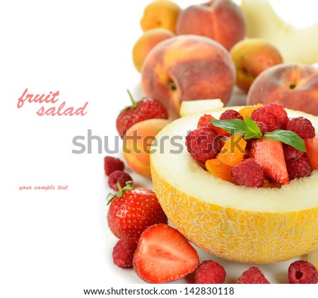 Fruit salad in melon on a white background - stock photo