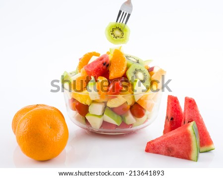 Fruit salad in take away bowls on white background