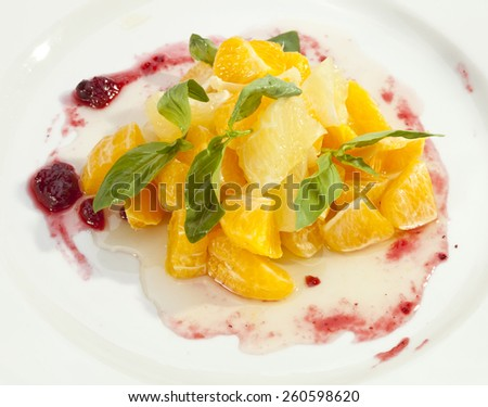 Fruit salad mixed from oranges and grapefruits - stock photo