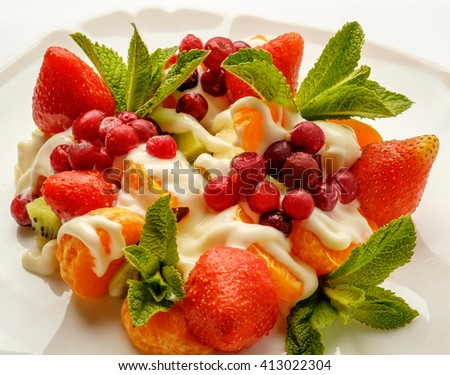 Fruit salad on a white background - stock photo