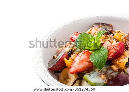 Fruit salad on the white plate horizontal