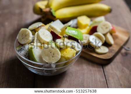 Fruit salad on the wood background
