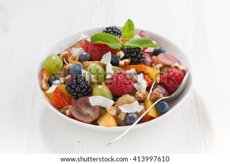 fruit salad on white wooden table, close-up - stock photo