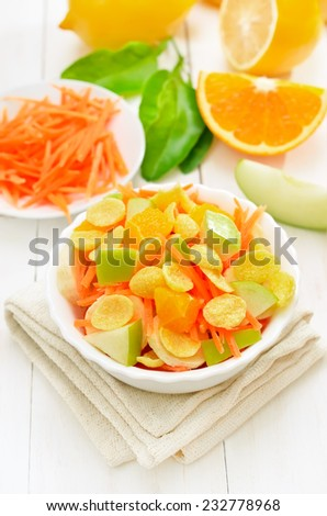 Fruit salad with cornflakes and fresh fruits on white wooden table - stock photo
