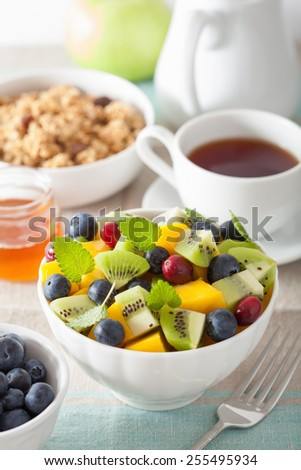 fruit salad with mango kiwi blueberry for breakfast - stock photo