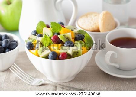 fruit salad with mango kiwi blueberry for breakfast  - stock photo