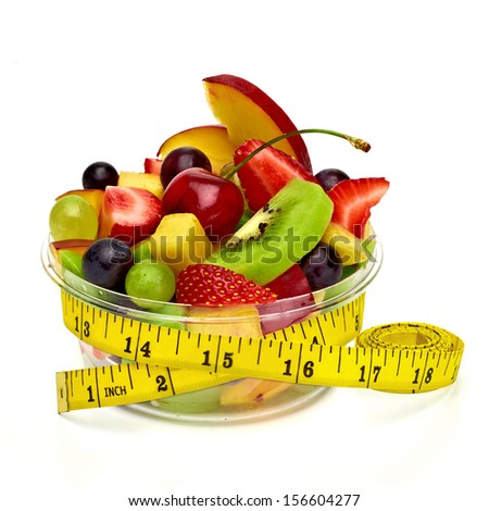 Fruit salad with measuring tape on white background