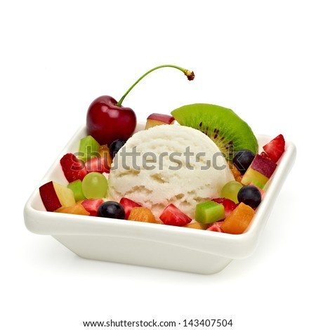 Fruit salad with vanilla ice cream in plate on white background - stock photo