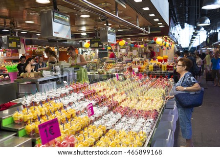 Fruit salads are seen for sale at 'La Boqueria' green market on July 15, 2013in Barcelona