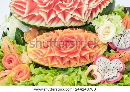 fruit setup for wedding dinner on beach. - stock photo