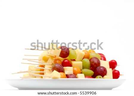 fruit shashlik sticks on a plate, on white background - stock photo