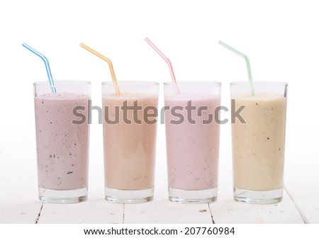 Fruit smoothies with blueberries , strawberry, kiwi and banana isolated on white background - stock photo