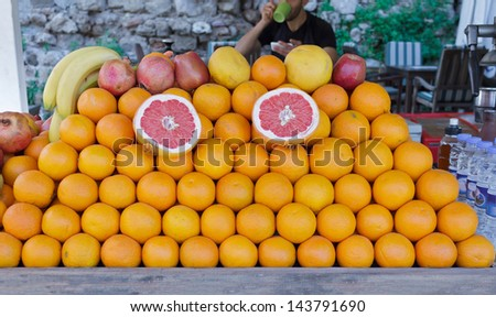 Fruit Stall with Oranges, Red Apples, Grapefruits, Bananas and Pomegranates