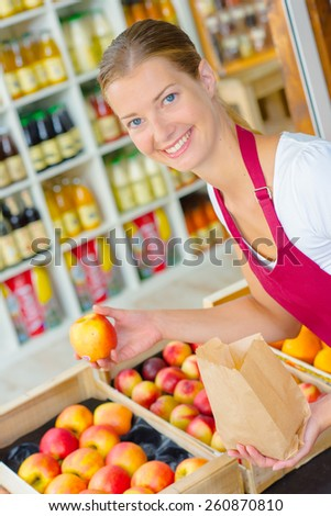 Fruit stall worker - stock photo