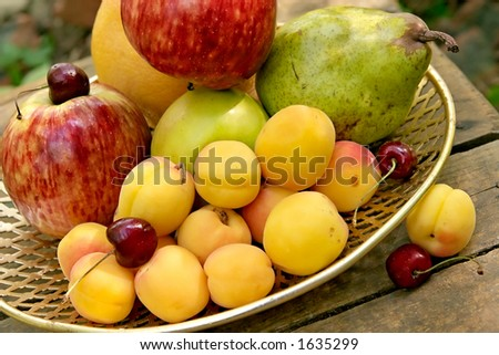 Fruit still-life on a solar court yard of a country house
